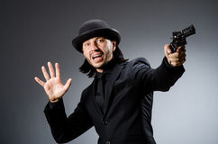 Man with gun. And vintage hat Royalty Free Stock Photos