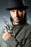 Man with gun. And vintage hat Stock Photos