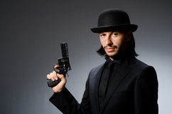 Man with gun. And vintage hat Royalty Free Stock Image