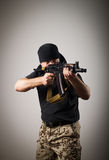 Man with gun Royalty Free Stock Photo
