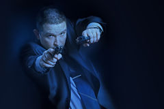 The man with guns. In a moonlight Royalty Free Stock Photography