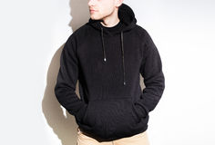 Man, guy in Blank black hoodie, sweatshirt, mock up isolated. Pl. Blank black hoodie, sweatshirt, mock up isolated. Plain hoody design presentation Stock Photos