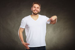 Man guy in blank shirt with copy space pointing. Stock Photography