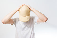 The man, guy in the blank white, beige baseball cap,  on a white Stock Image