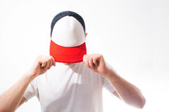 The man, guy in the blank white, red baseball cap,  on a white b. Ackground, mock up, free space, logo presentation , template for print,  design Stock Photos
