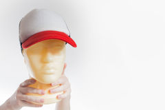 The man, guy in the blank white, red baseball cap,  on a white b. Ackground, mock up, free space, logo presentation , template for print,  design Royalty Free Stock Photography