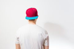 The man, guy in the blank white, red baseball cap,  on a white b. Ackground, mock up, free space, logo presentation , template for print Royalty Free Stock Photography