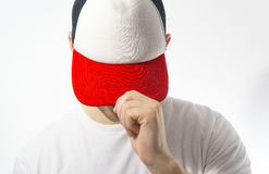 The man, guy in the blank white, red baseball cap, on a white background, mock up, free space, logo presentation , template for pr. Int, design Stock Photo