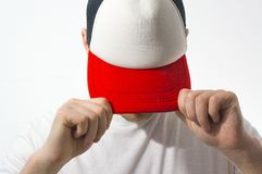 The man, guy in the blank white, red baseball cap, on a white background, mock up, free space, logo presentation , template for pr. Int, design Stock Images