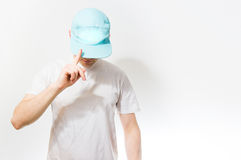 The man, guy in the blank white, Turquoise  baseball cap,  on a Stock Photo