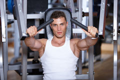 Man at the gym. Handsome man at the gym doing exercises Royalty Free Stock Images