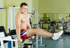 Man in gym. Portrait of sporty man doing exercise in gym and looking at camera Royalty Free Stock Photos