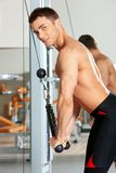 Man at the gym. Handsome man at the gym doing exercises Stock Photo