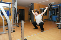 Man in gym. Young bodybuilder in a gym at workout Stock Images