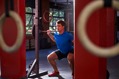 Man In Gym Clean And Jerk Lifting Weights Stock Photography