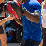 Man at Gym doing Fitness with Punching Mitts Stock Image