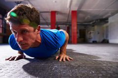 Man In Gym Doing Press-Ups Stock Photography