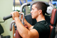 Man in gym exercising Stock Photo
