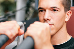 Man in gym exercising Stock Photography