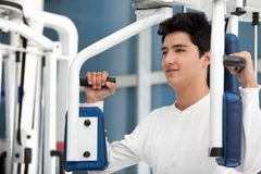 Man at the gym exercising Stock Photos