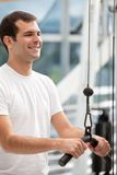 Man at the gym exercising Stock Image