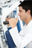 Man at the gym exercising Royalty Free Stock Photo