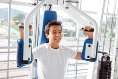 Man at the gym exercising Stock Photo