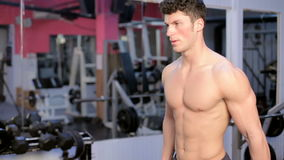 Man In The Gym Exercising. Athletic sport lifestyle stock video footage