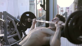 Man In The Gym Exercising. Athletic sport lifestyle stock footage