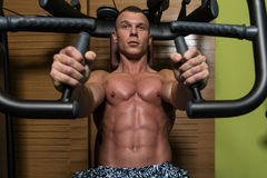 Man In The Gym Exercising Chest On Machine Royalty Free Stock Image