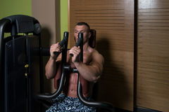 Man In The Gym Exercising Chest On Machine Stock Photography