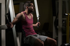 Man In The Gym Exercising Chest On Machine Royalty Free Stock Photography