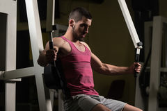 Man In The Gym Exercising Chest On Machine Royalty Free Stock Images