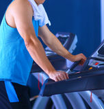 Man at the gym exercising on cross trainers Royalty Free Stock Photography
