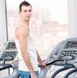 Man at the gym exercising. Run. Royalty Free Stock Photos