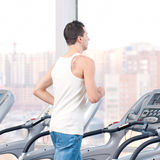 Man at the gym exercising. Run. Royalty Free Stock Images