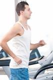 Man at the gym exercising. Run. Stock Image