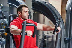 Man at gym have a workout stock photography