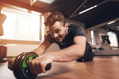 A man in the gym. He leads a healthy lifestyle. Man is engaged on the simulator in the support lying down. Stock Photo
