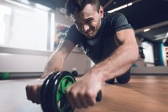 A man in the gym. He leads a healthy lifestyle. Man is engaged on the simulator in the support lying down. Royalty Free Stock Image