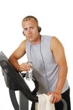 Man in the gym listening to music Stock Photo