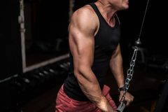 Man at the gym.man trains in the gym with weights. young guy doing exercises for good muscles. Fitness personal trainer working. S stock photos