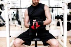 Man at gym preparing for workout Stock Image