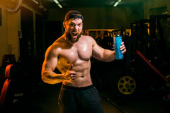 Man in the gym with shaker Stock Photography