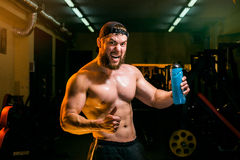 Man in the gym with shaker Royalty Free Stock Photos