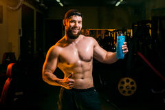 Man in the gym with shaker Royalty Free Stock Images