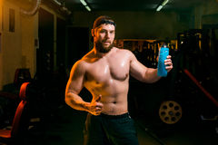 Man in the gym with shaker Royalty Free Stock Photo