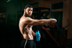 Man in the gym with shaker Royalty Free Stock Image