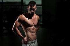 Man In Gym Showing His Well Trained Body Stock Photos