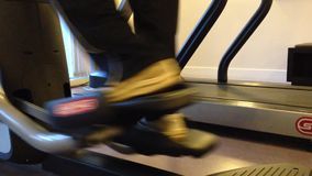 Man in the gym. Treadmill close up shot stock video footage